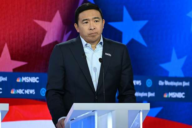(FILES) In this file photo Democratic presidential hopeful tech entrepreneur Andrew Yang speaks during the fifth Democratic primary debate of the 2020 presidential campaign season co-hosted by MSNBC and The Washington Post at Tyler Perry Studios in Atlanta, Georgia on November 20, 2019. - Andrew Yang announces withdrawal from Democratic presidential race (Photo by SAUL LOEB / AFP) (Photo by SAUL LOEB/AFP via Getty Images)