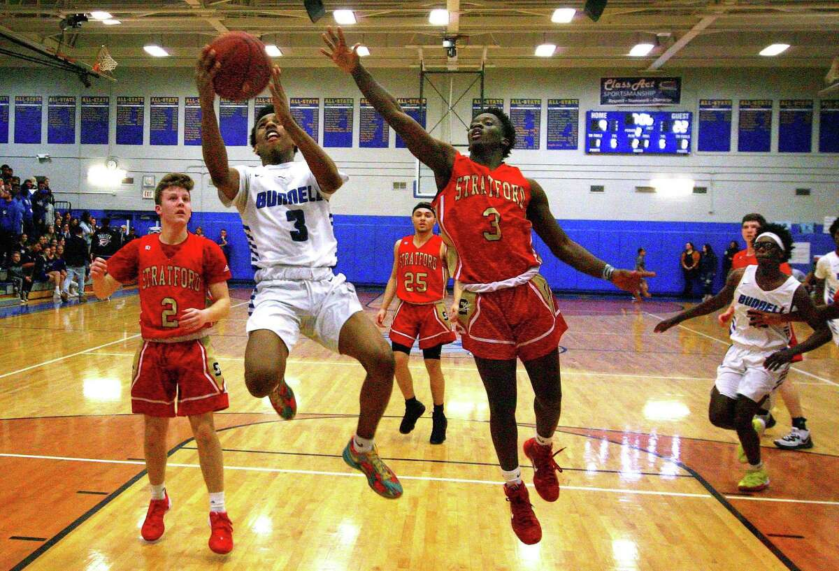 Bunnell's Jaden McDowell (3) looks for two points as Stratford's Kyle Robinson (3) defends during boys high school basketball in Stratford, Conn., on Tuesday Feb. 11, 2020.