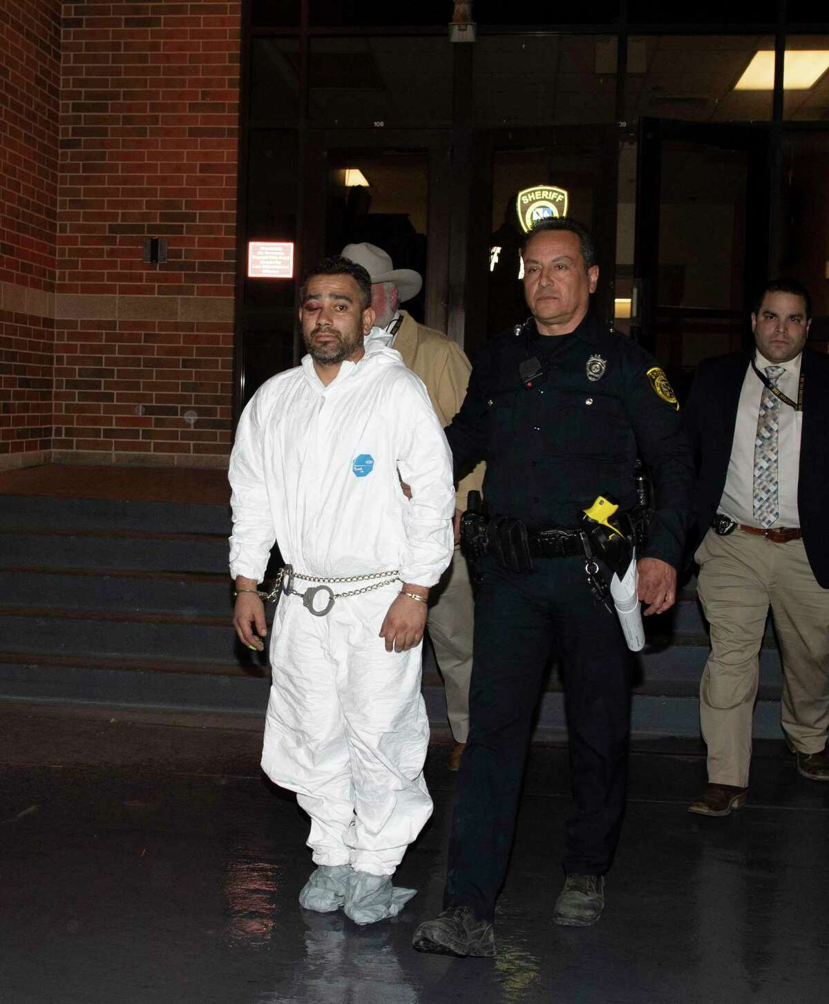 Michael Morales, suspect in two murders, is walked out of the Bexar County Sheriffs Office on Tuesday night, Feb. 11, 2020. He allegedly used a screw driver to kill a man over a drug debt, and then shot a woman afterward.