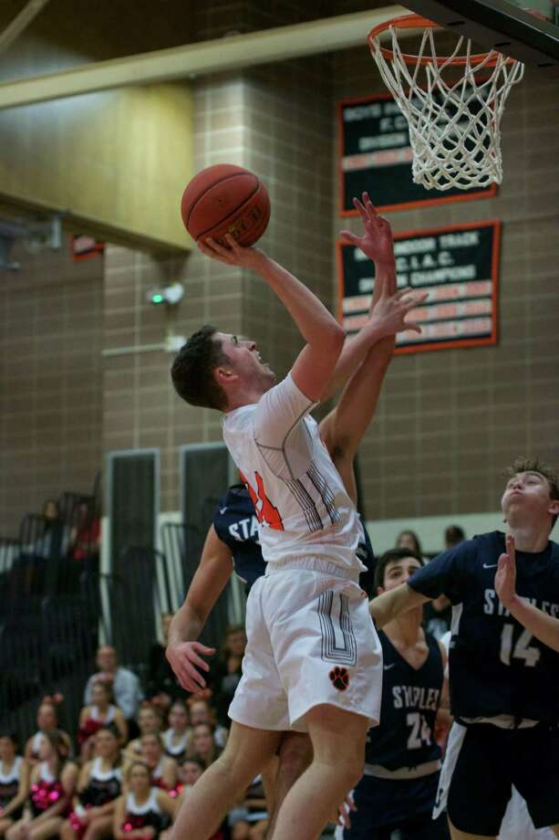 Luke McGarrity scored 24 points in Ridgefield's 62-51 victory over Staples. Photo: Allison Romeo / Contributed Photo