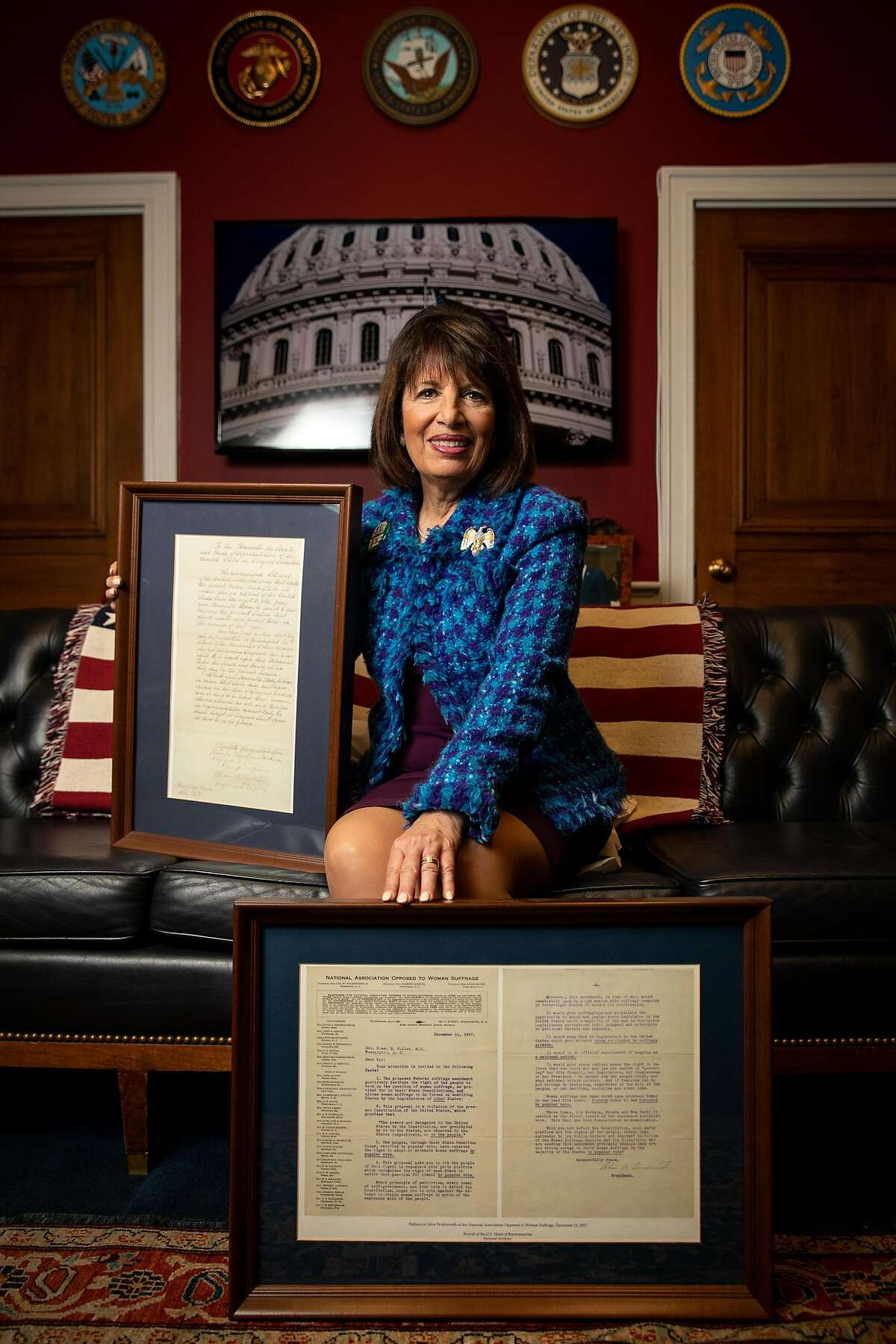 Rep. Jackie Speier, a Democrat representing California�s 14th congressional district, poses with a letter from Alice Wadsworth and the National Association Opposed to Women�s Suffrage, bottom, and a letter from Elizabeth Cady Stanton, urging swift passage of the 19th Amendment, in her Washington, D.C. office on Tuesday, February 11, 2020.