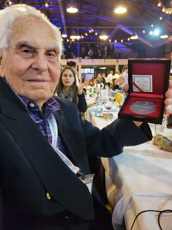The 75th anniversary of the liberation of Auschwicz was held Jan. 27. Sherman resident David Marks, a Holocaust survivor, was among those who traveled to Poland to visit Auschwicz for the first time in 75 years. While there, he received a Certificate of Remembrance. Photo: Courtesy Of Jewish Community Center / The News-Times Contributed