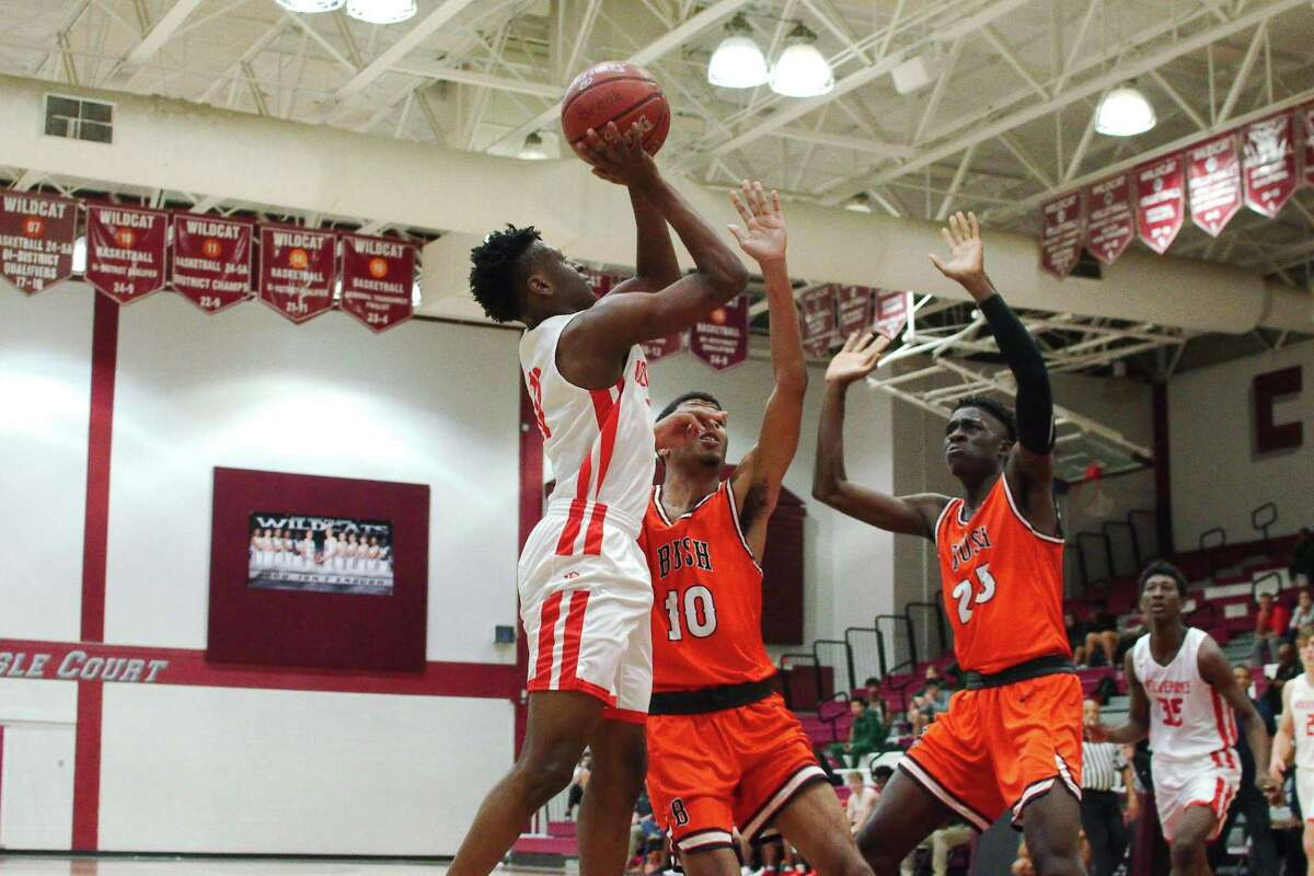 Clear Brook's Brandon Andrews (left), shown earlier this season in the Carlisle-Krueger Classic, scored 22 points to help lead the Wolverines past Clear Lake, 75-55, Tuesday night.