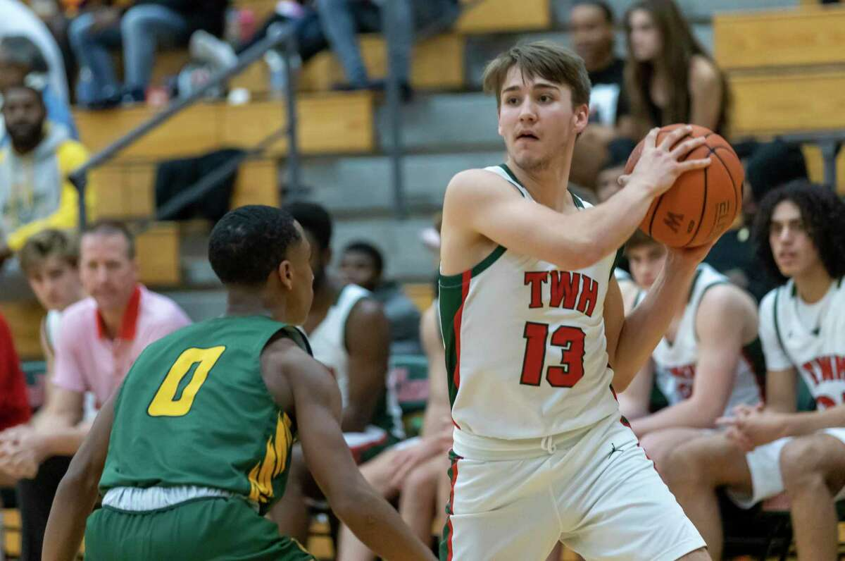 Woodlands guard Tyler Hveem (13) prepares to pass the ball while under pressure form Klein Forest point guard Jalen Collins (0) during the second half in a District 15-6A boys basketball game at The Woodlands High School in The Woodlands, Tuesday, Feb. 11, 2020.