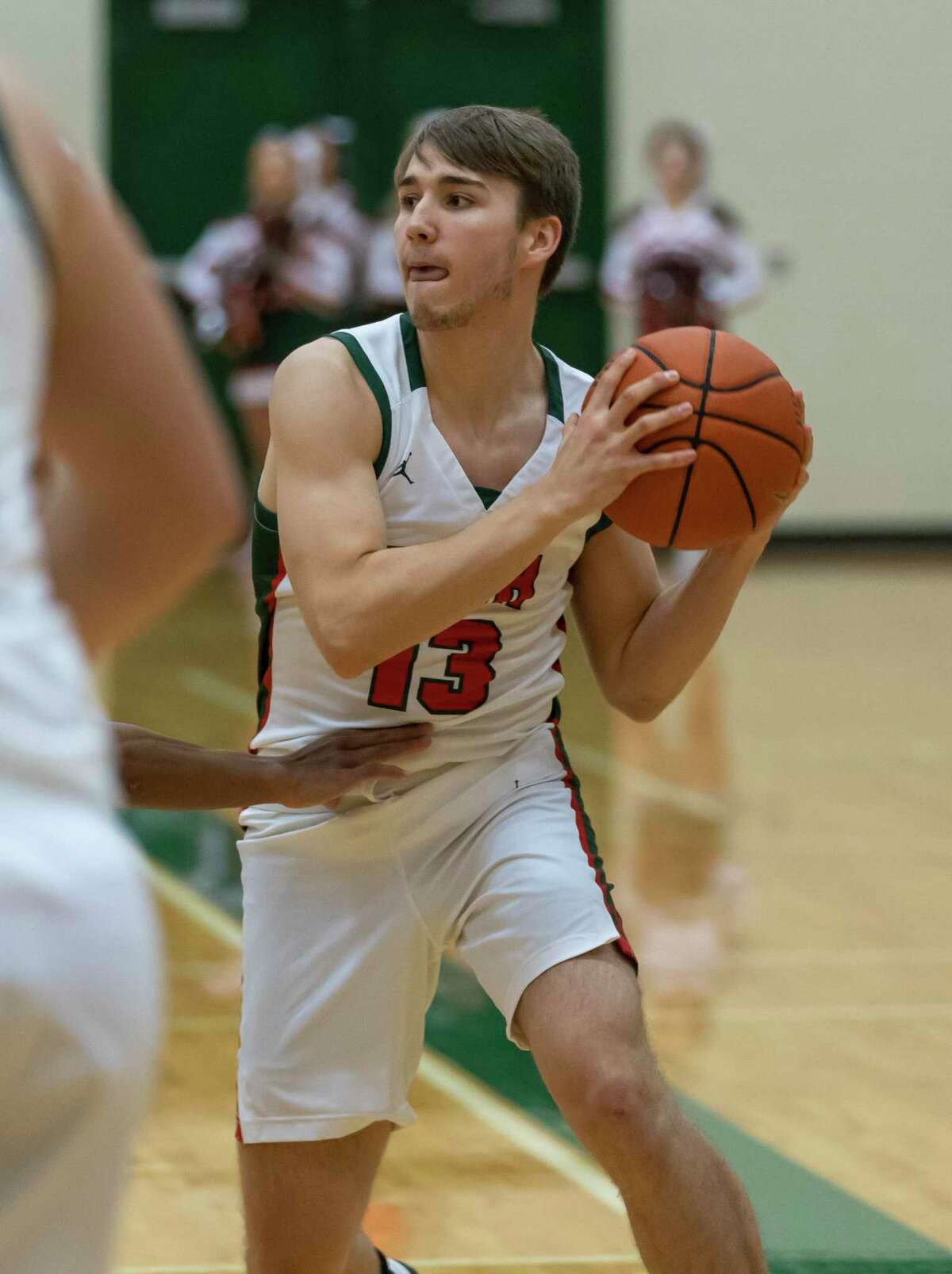 Woodlands guard Tyler Hveem (13) looks for an opening to pass the ball during the first half in a District 15-6A boys basketball game against Klein Forest high school at The Woodlands High School in The Woodlands, Tuesday, Feb. 11, 2020.
