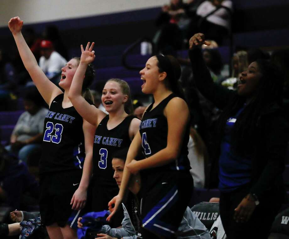 New Caney players react after a 3-pointer by power forward Tori Garza during the third quarter of a District 20-5A high school basketball game at Willis High School, Tuesday, Jan. 14, 2020, in Willis. Photo: Jason Fochtman, Houston Chronicle / Staff Photographer / Houston Chronicle © 2020