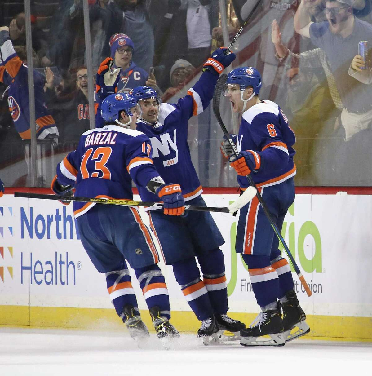 NEW YORK, NEW YORK - FEBRUARY 11: Ryan Pulock #6 of the New York Islanders celebrates his game winning goal at 19:21 of the third period against the Philadelphia Flyers at the Barclays Center on February 11, 2020 in the Brooklyn borough of New York City. The Islanders defeated the Flyers 5-3. (Photo by Bruce Bennett/Getty Images)