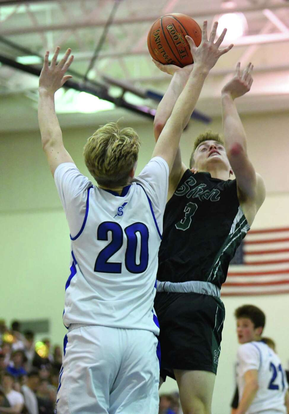 Shenendehowa's Luke Lavery drives to the basket against Saratoga's Luke Britton during a game on Tuesday, Feb. 11, 2020 in Saratoga Springs, N.Y. (Lori Van Buren/Times Union)