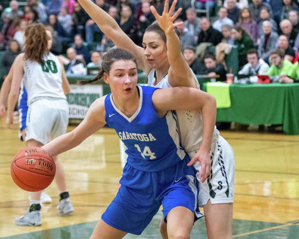 Saratoga freshman Natasha Chudy goes up against Shenendehowa junior Rylee Carpenter during a Suburban Council game at Shenendehowa High School on Tuesday, Feb. 11, 2019 (Jim Franco/Special to the Times Union.)