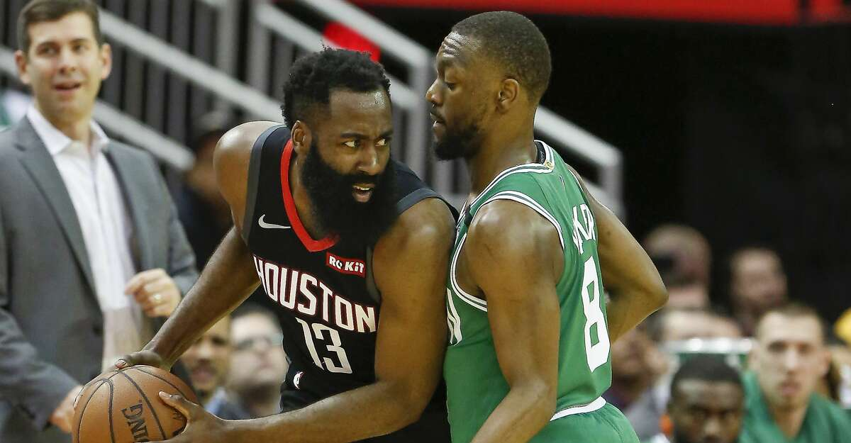 Houston Rockets guard James Harden (13) looks around Boston Celtics guard Kemba Walker (8) during the first half of an NBA basketball game at Toyota Center on Tuesday, Feb. 11, 2020, in Houston.