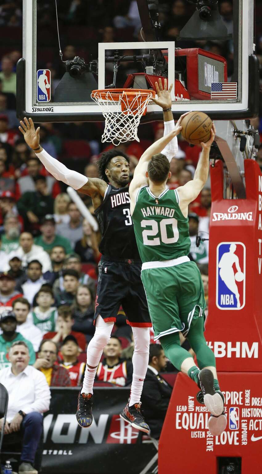 Boston Celtics forward Gordon Hayward (20) is met by Houston Rockets forward Robert Covington (33) during the second half of an NBA basketball game at Toyota Center on Tuesday, Feb. 11, 2020, in Houston.