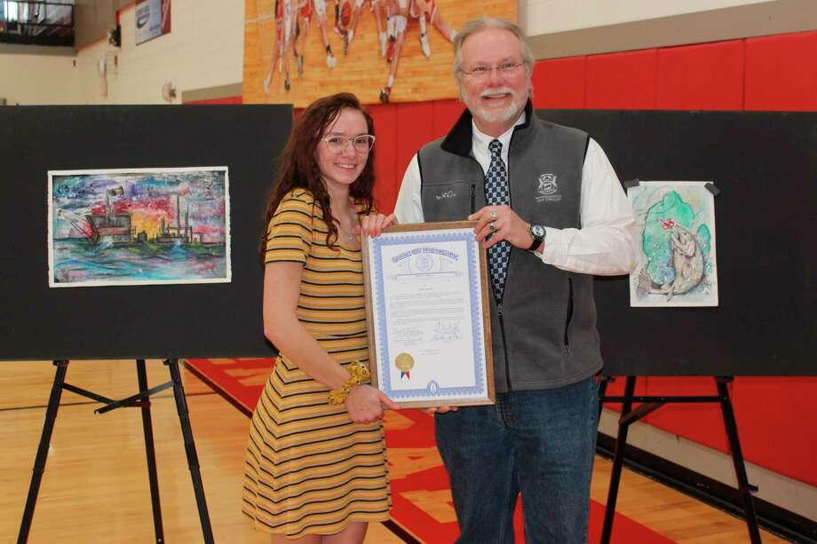 StateRep. Jack O'Malley honors Benzie Central senior Emma Quick as one of two winners of the Pure Michigan Art Competition sponsored by his office. (Photo/Robert Myers)
