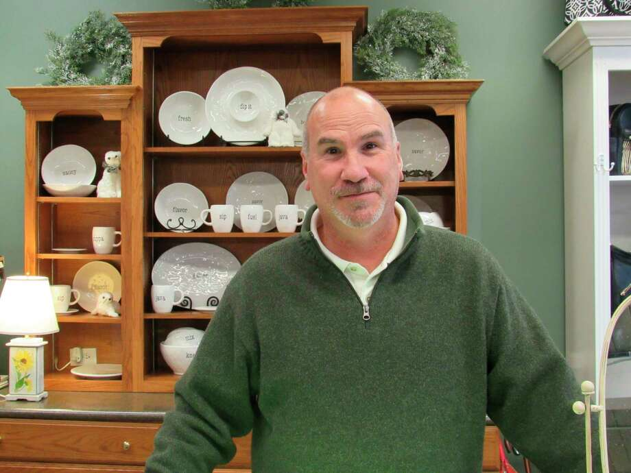 Joe Kozuch, co-owner of Village Green, poses inside the store. Joe and Maureen Kozuch have owned and operated the Midland floral shop for 20 years. (Victoria Ritter/vritter@mdn.net)