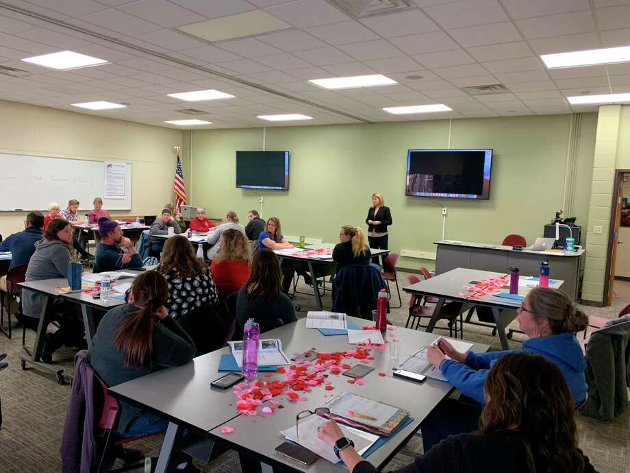 "Manistee County Child Advocacy Center family advocate Traci Smith recently presented ""Darkness to Light/Stewards of Children"" training for 65 members of the Manistee Intermediate School District staff. (Courtesy photo)"