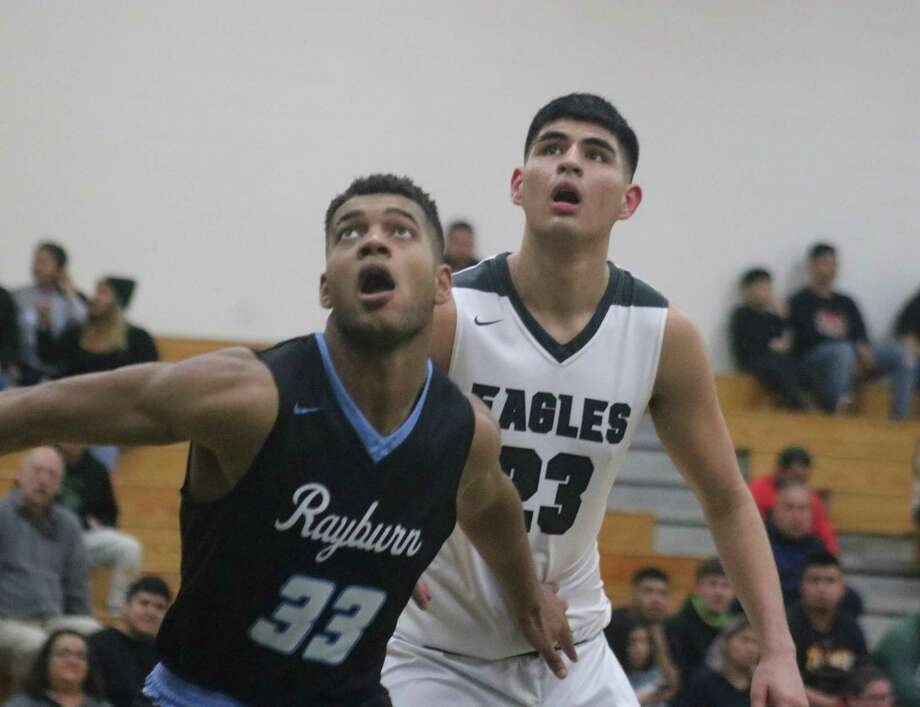 Rayburn's Je'lin Samuels (33) and Pasadena's Nelson Herrera look for an advantage under the glass as a foul shot is attempted in second-half action Tuesday night. Photo: Robert Avery