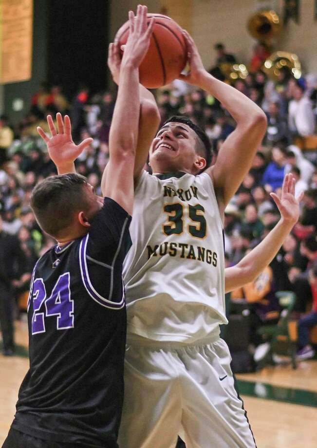 Bryan Garcia led Nixon with 28 points as the Mustangs clinched a playoff spot Tuesday. Photo: Danny Zaragoza /Laredo Morning Times