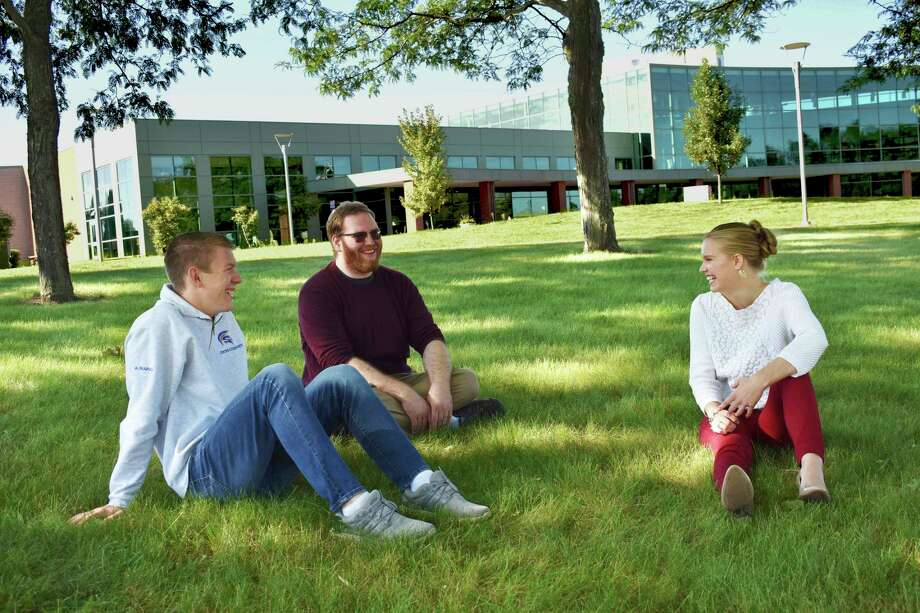 West Shore Community College students enjoy chatting on the campus lawn. (Photo submitted by WSCC)