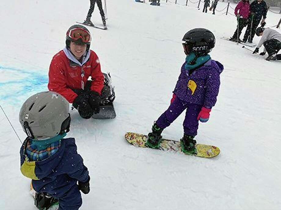 Nic Rice, a sophomore in Ferris State University's hospitality management program, works with youngsters at a SnowSports Academy session at the Boyne Mountain Resort. Rice, of Lansing, is among the Ferris students visiting the resort each Saturday, as part of their ski recreation management course studies. (Courtesy photo)