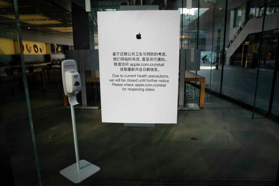 In this photo taken on Monday, Feb. 10, 2020, a closed notice is seen on an Apple store at the capital city's popular shopping mall following the COVID-19 outbreak, in Beijing. Photo: Andy Wong, AP / Copyright 2018 The Associated Press. All rights reserved