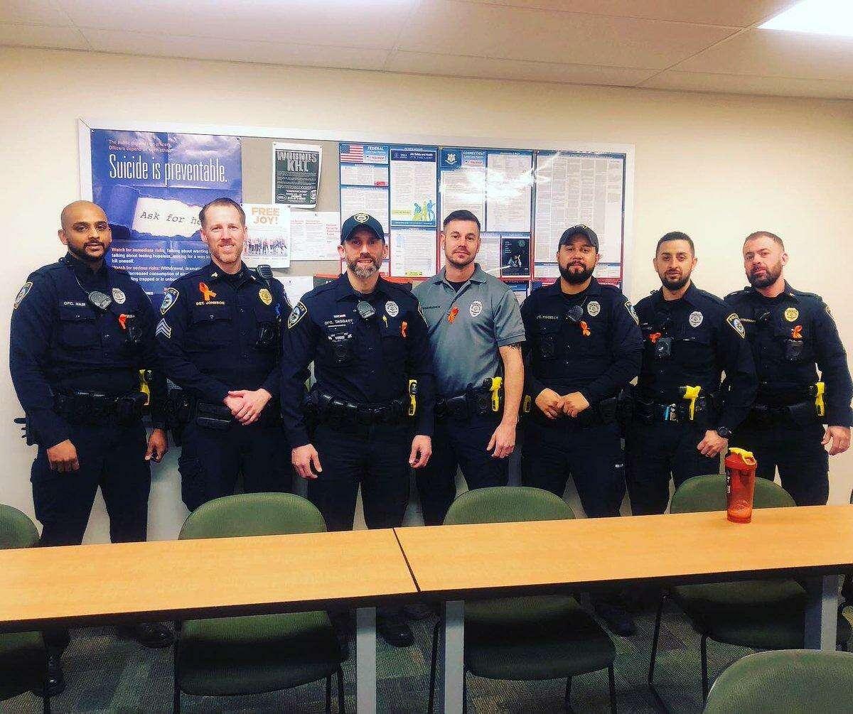 Darien Police wore orange ribbons for