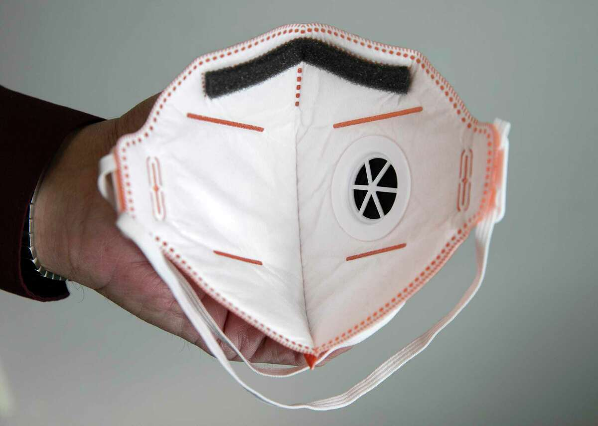Clinic Manager Frank Perez displays the back of an N95 face mask at the Foothill Community Health Center on Monday, February 10, 2020 in San Jose, California.
