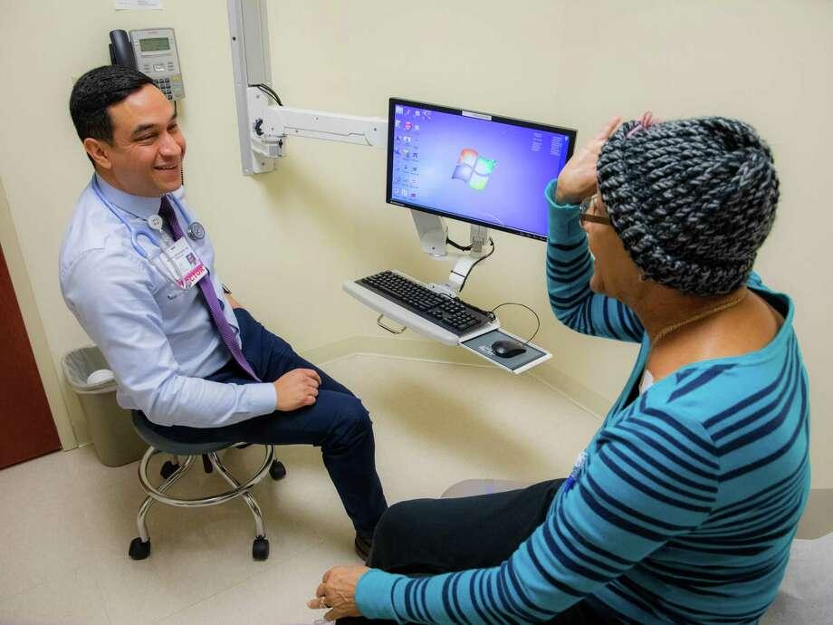 Dr. Alvaro Menendez speaks to a patient at the Hartford HealthCare Cancer Institute in Windham Hospital. Photo: Carl Jordan Castro / Connecticut Health I-Team / CJ_Castro