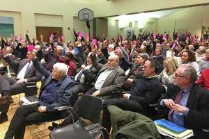 Residents of Guilford  packed a room at the Nathanael B. Greene Community Center  Feb. 11and voted to move forward with a plan to develop affordable housing on the Woodruff property.