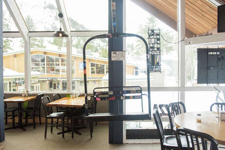 There's a chair from the old KT-22 lift that's been securely hanging in the bar since the '90s. Photo: Blair Heagerty / SFGate