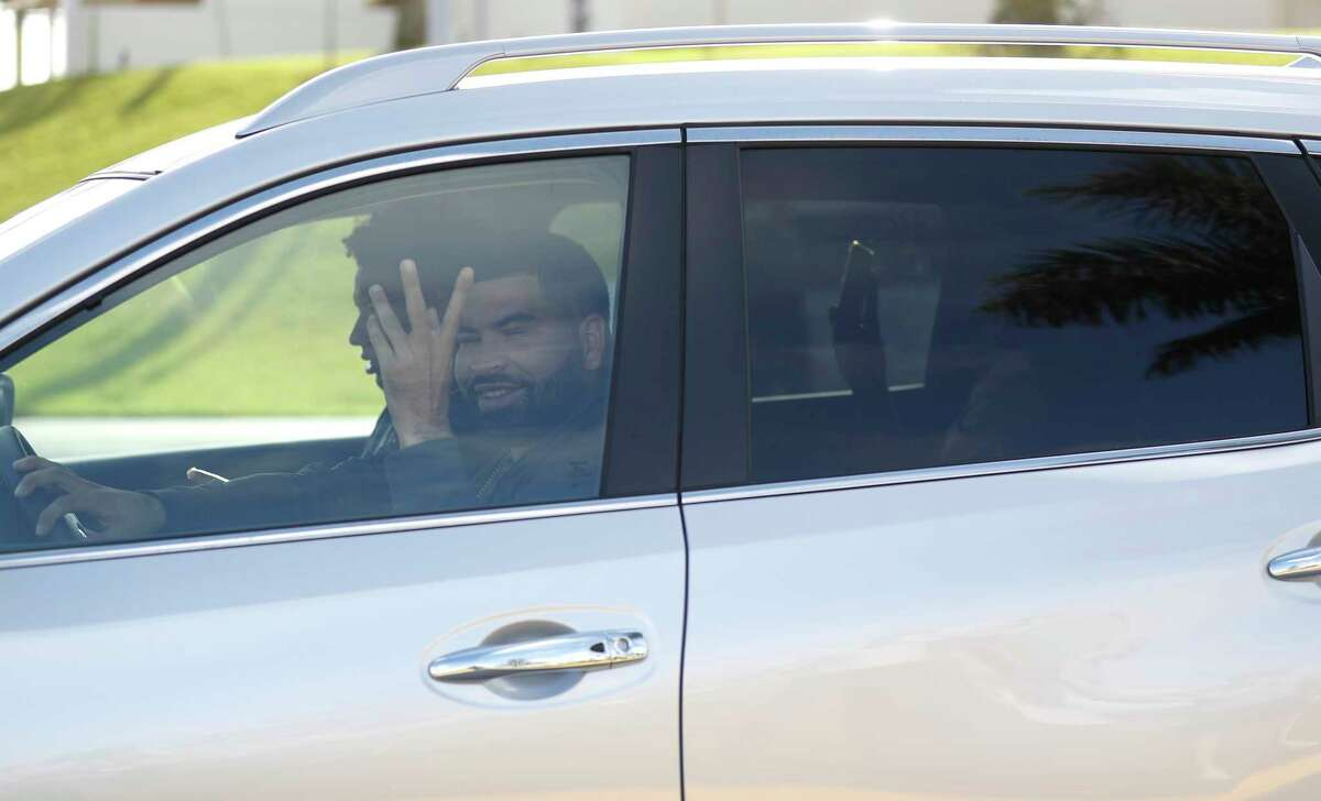 Houston Astros pitcher Jose Urquidy waves to media gathered outside of the Houston Astros spring training facility at the Fitteam Ballpark of The Palm Beaches, in West Palm Beach, Wednesday, Feb. 12, 2020. Astros pitchers and catchers reported to camp today, however the media was kept out of the facility.