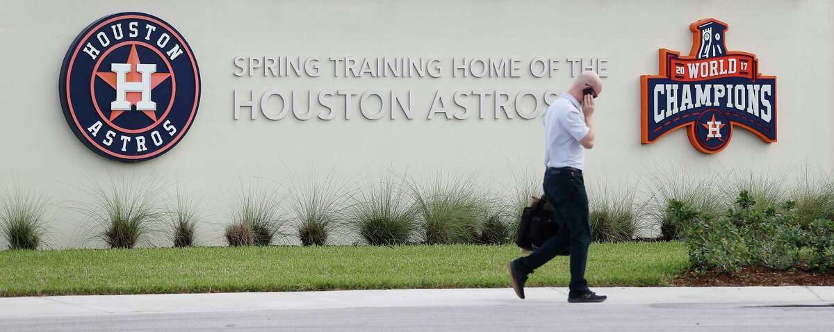 Houston Astros Senior Director of Business Operations Dan O'Neill walks past the signs outside of the Houston Astros spring training facility at the Fitteam Ballpark of The Palm Beaches, in West Palm Beach, Wednesday, Feb. 12, 2020. Astros pitchers and catchers reported to camp today, however the media was kept out of the facility.