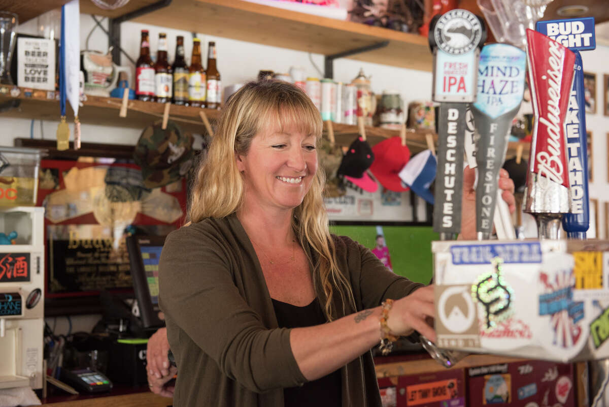 Co-owner Katja Dahl pours a beer at Le Chamois in Squaw Valley.