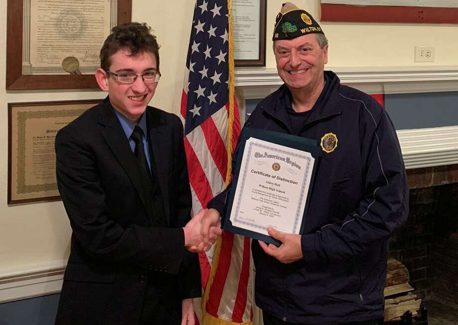 Aidan Hall, a sophomore at Wilton High School, is joined by American Legion Post 86 Commander Bill Glass. Aidan will represent Post 86 in the American Legion's Post Oratoratical contest on Saturday, Feb. 15, at Fairfield Public Library. Photo: Jeannette Ross / Hearst Connecticut Media / Wilton Bulletin