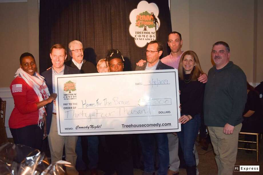 """Four U.S. military veteran comedians will be doing stand-up at Vazzano's Four Season in Stratford March 6 for the fourth annual """"For Veterans By Veterans"""" Comedy Night to benefit homeless veterans. Pictured is a check presentation from Comedy Night 2019, featuring Homes for the Brave board members. Photo: Homes For The Brave / Contributed Photo"""