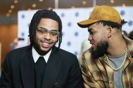 New Minnesota Timberwolves NBA basketball player D'Angelo Russell, left, chats with Timberwolves' Karl-Anthony Towns after Russell was introduced at a news conference, Friday, Feb. 7, 2020, in Minneapolis, following a trade that sent Timberwolves' Andrew Wiggins to the Golden State Warriors.