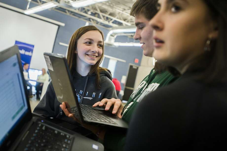 "Morgan Glann, left, chats with Gaberial Sturgeon, center, and Allya Ankobiak, right, as they take part in the ""Reality Store,"" hosted by the Midland County Educational Service Agency, Tuesday, Feb. 11, 2020 at Meridian Early College High School. During the exercise, students select a career path, make financial decisions, and fill out a budget to simulate how those decisions will pan out. (Katy Kildee/kkildee@mdn.net) Photo: (Katy Kildee/kkildee@mdn.net)"