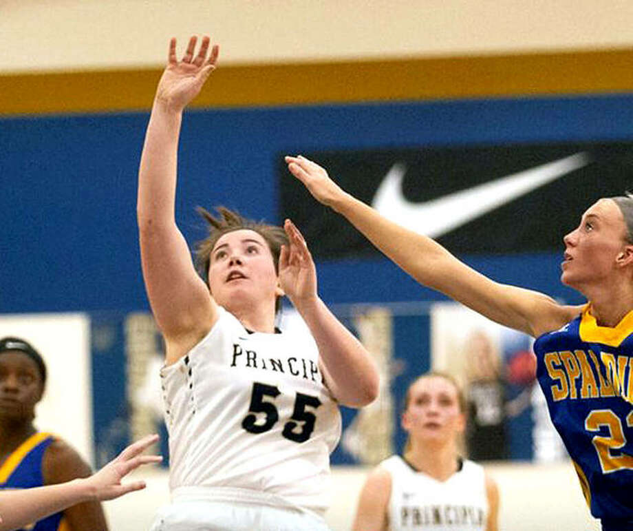 Principia College's Sophia (55) puts up a shot during Tuesday night's game against Spalding University in Elsah. Hatheway scored 20 points and passed the 1,000 point career scoring mark in three years. Photo: Principia Athletics