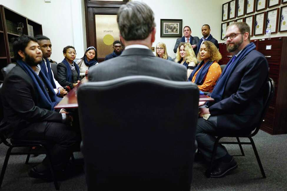 Albany High School, AP Government teacher, Sean Fitzsimons, right, and students from his class listen as Senator Neil Breslin speaks during a meeting at the Capitol on Wednesday, Feb. 12, 2020, in Albany, N.Y. (Paul Buckowski/Times Union)