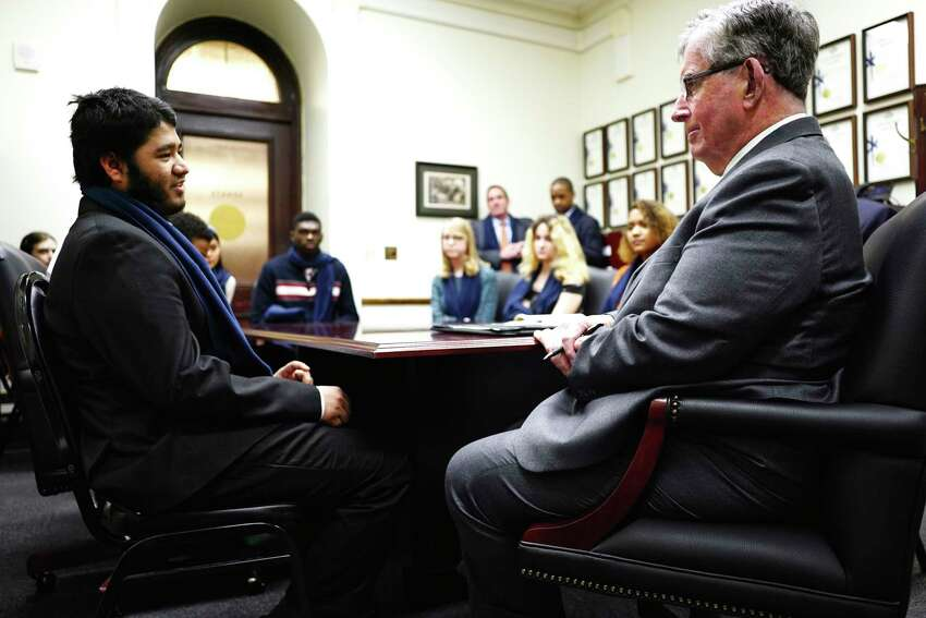 Albany High School senior Hassibul Hassan, left, talks about the importance of AP classes as students from the school's AP Government class met with Senator Neil Breslin, right, at the Capitol on Wednesday, Feb. 12, 2020, in Albany, N.Y. (Paul Buckowski/Times Union)