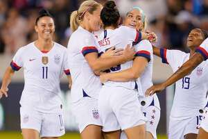 Christen Press #20 of the United States celebrates her goal with Julie Ertz #8 and teammates during a game between Costa Rica and USWNT at BBVA Stadium on February 03, 2020 in Houston, Texas.