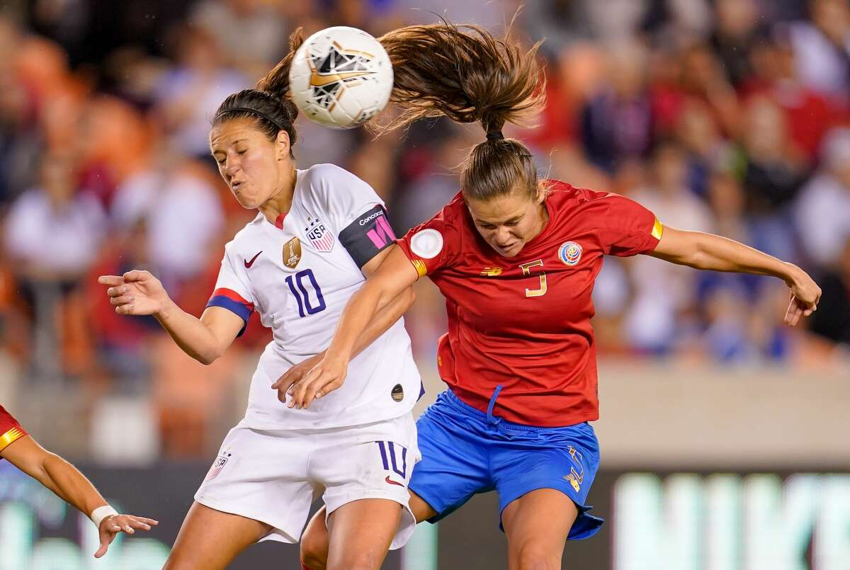 Carli Loyd #10 of the United States battles in the air for a ball with Fabiola Sanchez #5 of Costa Rica during a game between Costa Rica and USWNT at BBVA Stadium on February 03, 2020 in Houston, Texas.