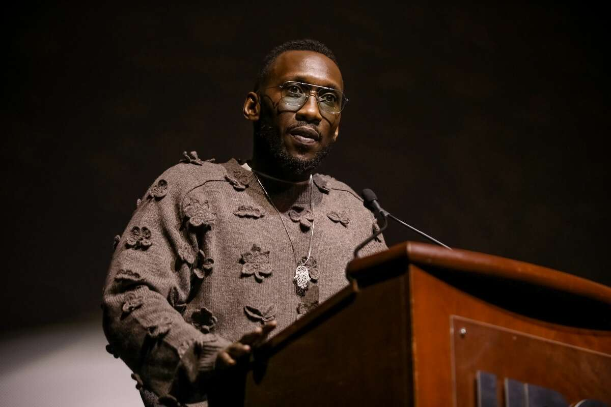 Actor and executive producer Mahershala Ali speaks onstage before the premiere of