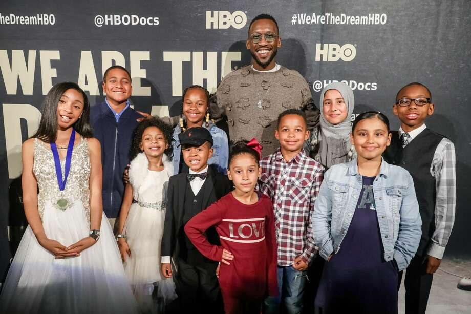 """Executive producer Mahershala Ali poses for a photo with young orators on the red carpet for """"We Are The Dream"""" on Feb. 11, 2020, in Oakland, California. (Photo by FilmMagic/FilmMagic for HBO) Photo: FilmMagic/FilmMagic For HBO"""