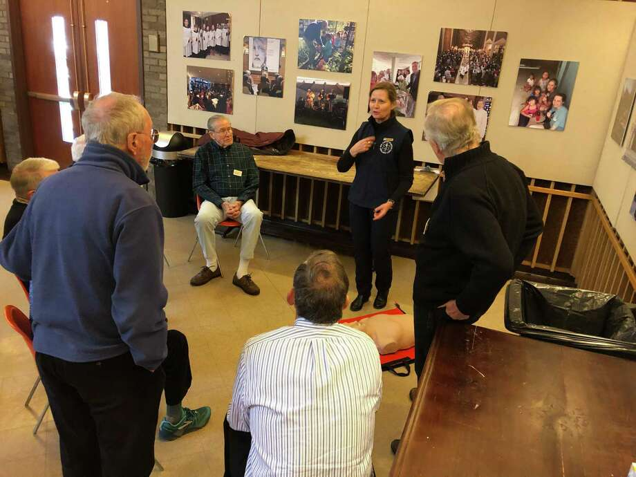 Volunteers from New Canaan Emergency Medical Services (also known as the New Canaan Volunteer Ambulance Corp) recently taught hands-only CPR to members of the New Canaan Men's Club. Photo: Contributed Photo / New Canaan Advertiser Contributed