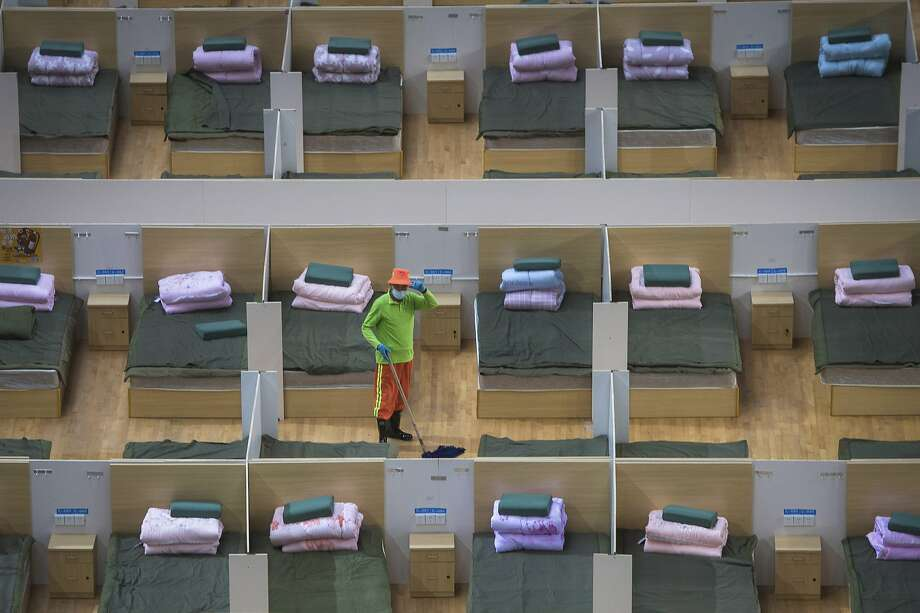 A worker cleans the floor of a temporary hospital with 1,100 beds converted from a sports center in Wuhan in central China's Hubei Province. Photo: Xinhua News Agency