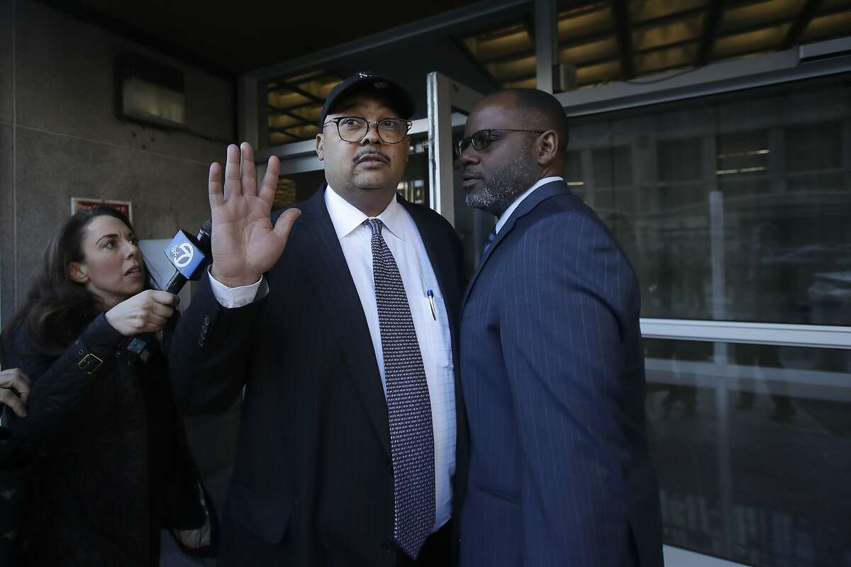 Mohammed Nuru, director of San Francisco Public Works, center, gestures as he leaves a federal courthouse with attorney Ismail Ramsey, right, in San Francisco, Thursday, Feb. 6, 2020. (AP Photo/Jeff Chiu)