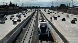 A new diesel-powered train runs on the track during a test run of a new BART extension that runs from the Pittsburg-Bay Point station to Hillcrest Avenue in Antioch, Calif., on Wednesday, May 23, 2018. The new people moving line runs down the middle of Highway 4 for that length