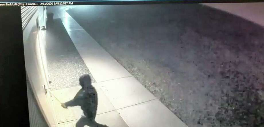 Middletown police have shared a video which shows the suspect in a robbery at the Greater Middletown Military Museum. Wearing a mask the individual used an ax to force entry into the building, authorities said. Photo: YouTube Screen Grab