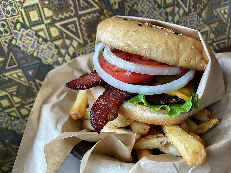 Burger options include a single with bacon and American cheese with a side order of fries at Trilogy Burger Bistro in Stone Oak. Photo: Mike Sutter /Staff