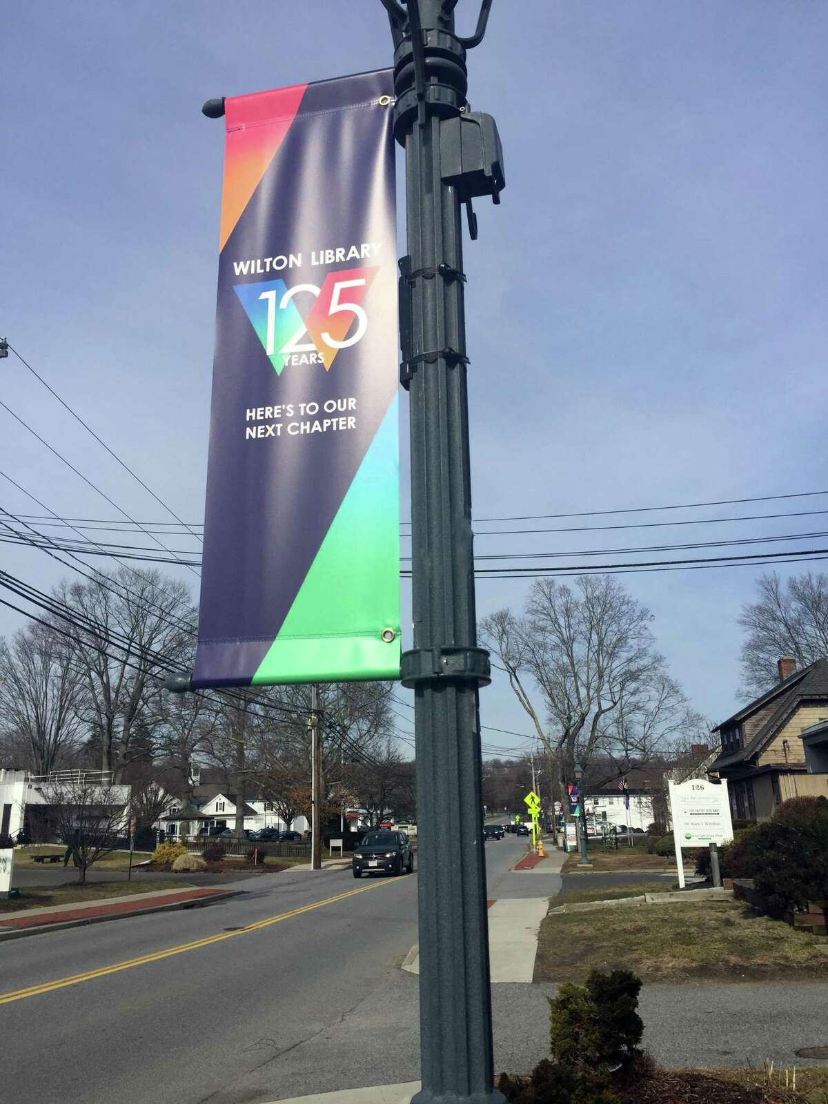 Banners have been placed on lamp posts throughout Wilton Center announcing the 125th anniversary of Wilton Library.