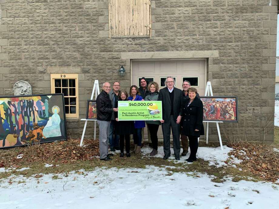 The Consumers Energy Foundation presents a $40,000 grant check to the Port Austin Artist in Residence program. (Courtesy Photo)